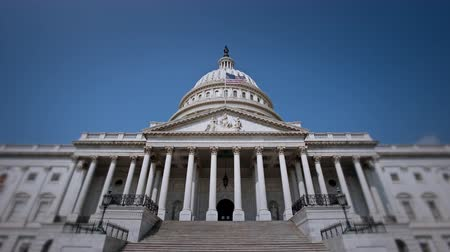 congress : Establishing shot of the Capitol Building in Washington, DC. 4K UHD broadcast quality. U.S politics concept.
