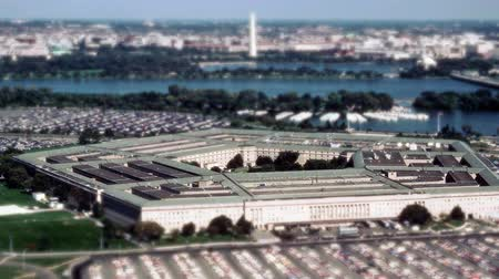 komuta : Aerial establishing shot of the Pentagon building with a small amount of traffic in front. 4K UHD.