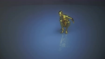 tancerze : A golden human form performs a dance routine but runs out of steam and deflates onto the floor.