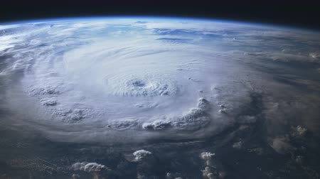 categoria : Satellite view of a large hurricane with a well defined eye. 4K UHD.