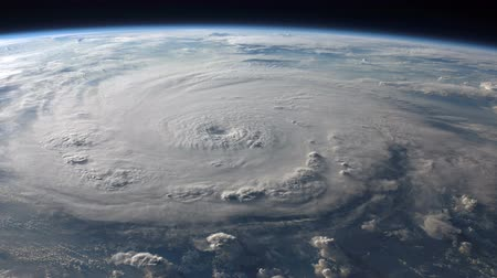 definição : Satellite view of a large hurricane with a well defined eye. 4K UHD.