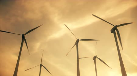 obnovitelný : Gorgeous shot of a working wind farm with spinning turbines.