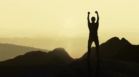 достигать : Animation depicting the concept of achieving goals with accompanying feeling of victory and accomplishment. 4K silhouette animation.