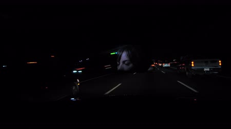 excesso de velocidade : Woman driving at night with face visible on the rear view mirror. Broadcast quality 4K footage. Vídeos