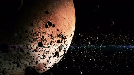 meteorite : 4K animation of an asteroid field surrounding a moon. Stock Footage