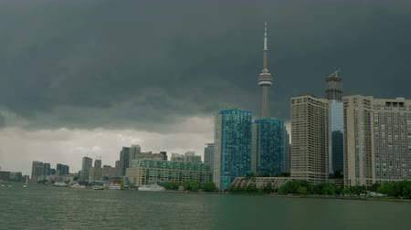 bank tower : Toronto Skyline from Lake Ontario with storm clouds overhead. 4K footage.