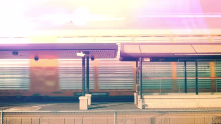 ekspres : Retro styled footage of a train passing a station. 4K. Stok Video