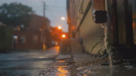 bica : Cinematic establishing shot of rain draining into an alleyway during a storm. 4K footage.