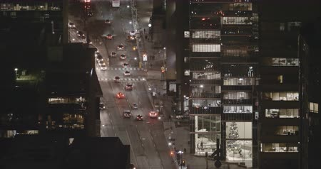 4K Timelapse view of traffic in downtown Toronto at night. All logos and trademarks removed in post.