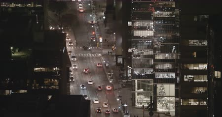esparso : Establishing shot of sparse traffic in a modern city late at night. Cinema 4K Footage.