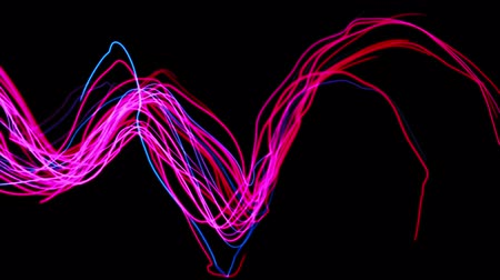beatiful : Abstract neon streaks dance across the frame. 4K 3D animation.