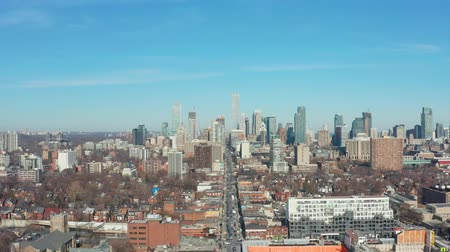 4K Aerial Establishing shot of a Downtown Toronto Neighborhood in late March.