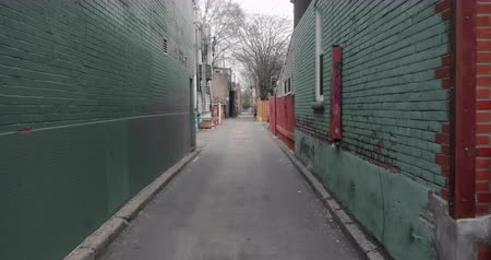 4K establishing shot of an empty alley in a big city. Shot on a gimbal with subtle motion.