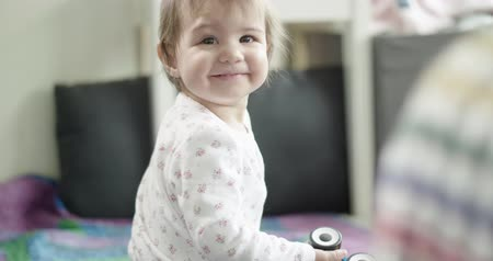 suçsuzluk : Beautiful baby playing with her toys. Real life, candid footage. Stok Video