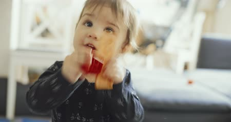 Cute baby girl playing with toys. Shot on a cinema camera. 4K.