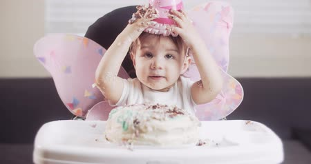 Baby girl celebrates her first birthday. Shot in RAW 4K on a cinema camera.