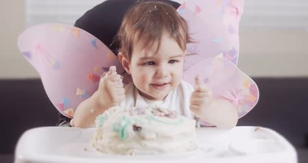 smashing : Baby girl celebrates her first birthday. Shot in RAW 4K on a cinema camera.