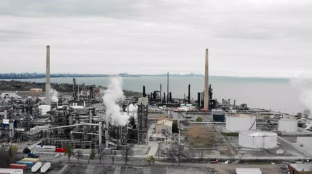 Establishing shot of an oil, petroleum, gas refinery. Cinematic 4K footage.
