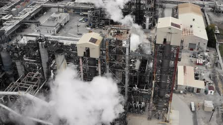 smokey : Establishing shot of an oil, petroleum, gas refinery. Cinematic 4K footage.