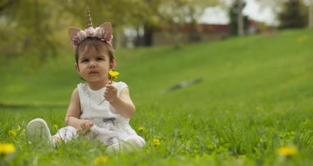 dmuchawiec : Adorable baby girl at the park dressed as a unicorn. Shot in 4K RAW on a cinema camera. Wideo
