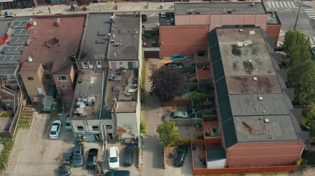 thoroughfare : Aerial establishing shot of an empty alley in a big city. Cinematic 4K footage.