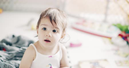 suçsuzluk : Incredible cute baby girl playing indoors. Shot on a cinema camera in 4K RAW.