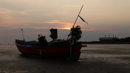 samut : Beautiful silhouette fishing boat and Sunset over the sea. Bangpu Recreation Center (Samut Prakan, Thailand)