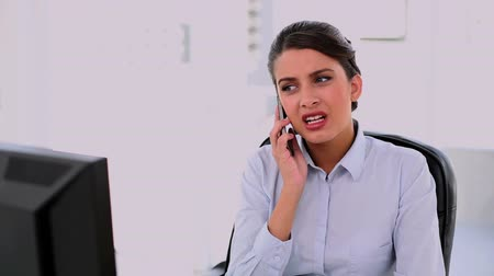брюнет : Irritated beautiful brunette businesswoman making a phone call at office