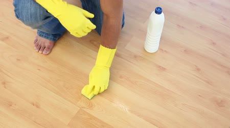 sünger : Man cleaning floor with sponge at home Stok Video