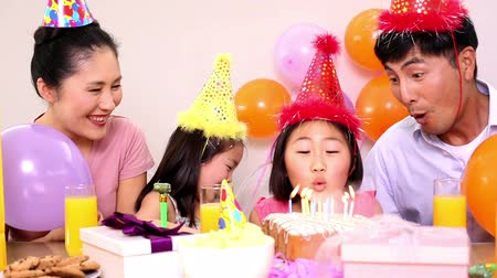 home life : Happy family celebrating a birthday at home Stock Footage