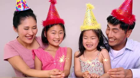 doğum günü : Happy family celebrating a birthday and holding sparklers at home