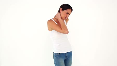 zpátky : Slim model in jeans with back and neck ache on white background