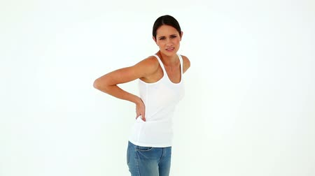 zpátky : Slim model in jeans with a back ache on white background