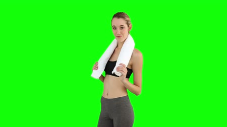 vékony : Slim model posing with towel on her shoulders on green screen background