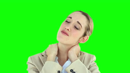 krk : Businesswoman rubbing her sore neck on green screen background Dostupné videozáznamy