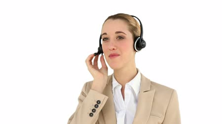discussão : Smiling call centre agent talking on the headset on white screen background