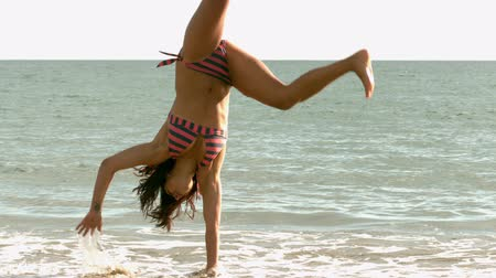 pretty : Woman doing cartwheel in slow motion