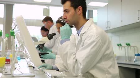 tudományos : Team of serious science students working together in the lab at the university
