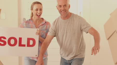 vzrušený : Excited couple moving into new home in slow motion