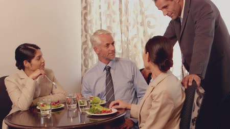 nóbl : Business people having a lunch meeting in slow motion