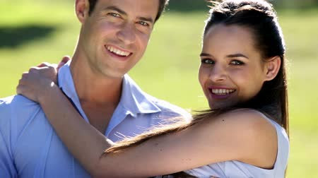 transportar : Man carrying his pretty girlfriend in the park on a sunny day