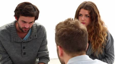counselling : Rehab group sitting in a circle at group therapy session Stock Footage
