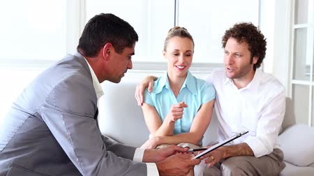 guy home : Couple in meeting with a financial adviser in his office