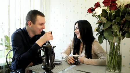 young spouses drink tea and have fun chatting