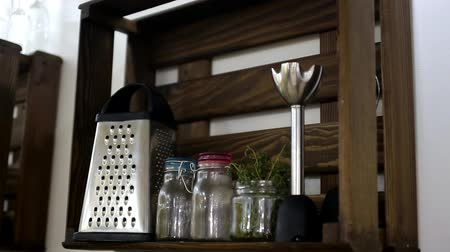 kitchen accessories on a dark wooden shelf Dostupné videozáznamy