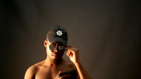 afro american guy in a cap and glasses depicts a policeman