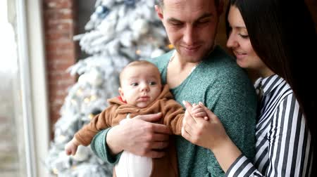 fidelity : young family with a young child on a background of a christmas decor Stock Footage