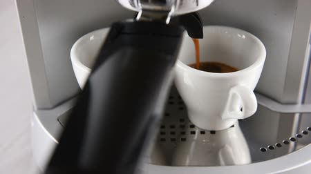 expressed : coffee machine in operation fills two white cup of coffee. Shooting clip with circular motion. Stock Footage