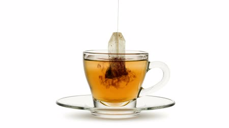 infusion : Animated looping image, tea bag in glass cup of tea on white bachground.