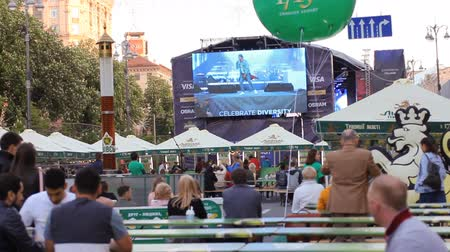 fan zone : KIEV UKRAINE May 5, 2017. Maidan . Khreshchatyk Street. Fan zone and a concert floor. Speech of the pupils of past competitions on the stage. Eurovision-2017.fan zone Eurovision Village on Kreschatik street. food-court Stock Footage